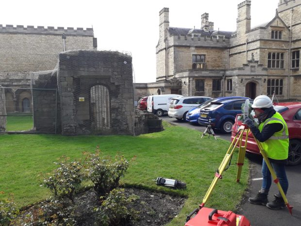 Female using surveying equipment at Lincoln Bishops Palace